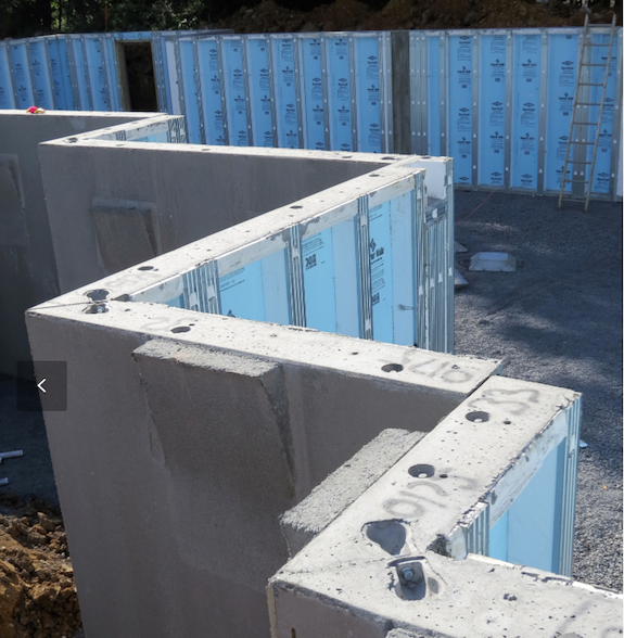 Build a house foundation in one day precast concrete is for Superior wall foundation