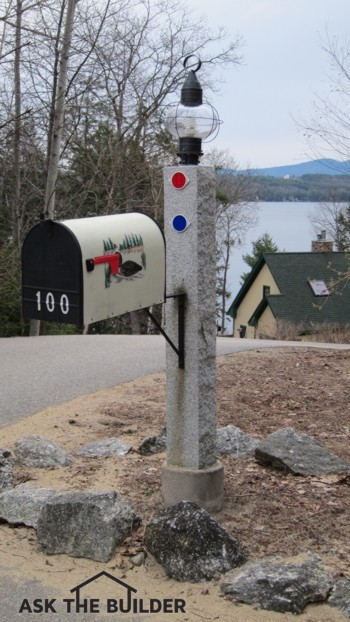 Here's a lamp post pole doing double duty with an attached mailbox.  Photo Credit: Tim Carter