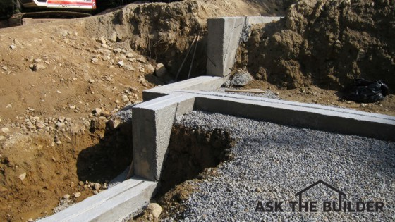 Here's a foundation footing that's making a transition from one level to another. It's poured continuously for extra strength. Photo Credit: Tim Carter