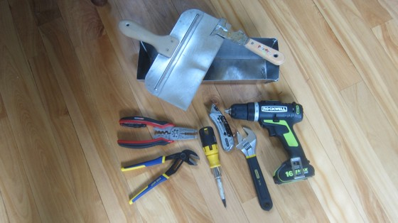 These are just a few of the basic tools you'll need to do home repairs around your home. Photo Credit: Tim Carter