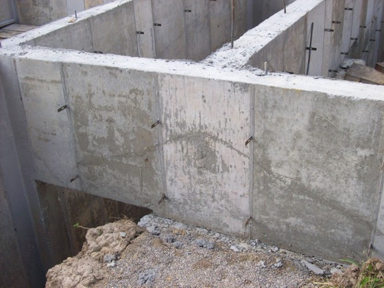 Poured concrete foundation defect ask the builder for Basement foundation walls