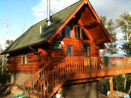 Here's a small log cabin that looks big because of the roof pitch and generous overhangs. Photo Credit: Scott Brown