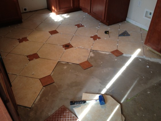 This patterned ceramic tile floor is well on it's way to completion. The plastic spacers could cause problems Photo Credit:  Marilyn H., New Bern, NC