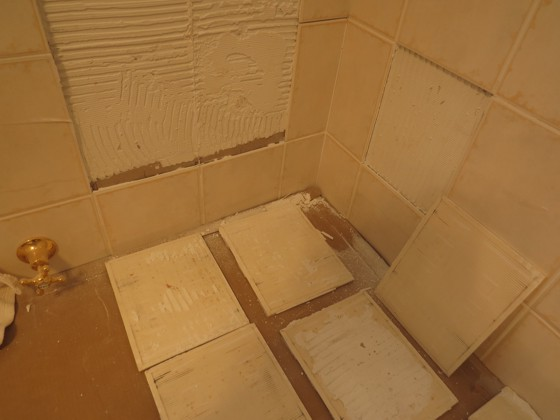 These wall tiles had poor adhesion to the wall. The reasons for failure are many. Photo Credit:  Lloyd May