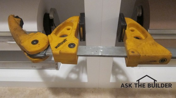 Using professional ratcheting squeeze clamps are a must if you want to expertly connect cabinets. Photo Credit: Tim Carter