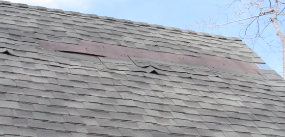 You might think you need a new roof when you see damage like this, but it's possible you can repair the roof in less than an hour. Photo Credit: Tim Carter