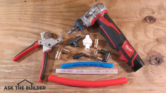 Here are different pieces of pex pipe, fittings and a cool cordless expanding tool that allows you to make connections in seconds. Photo credit: Tim Carter