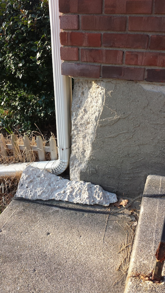 this chunk of concrete came off because the brick and mortar and poured concrete expand and - Fixing Foundation Cracks