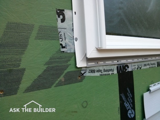 See the white tape that says Flashing Tape? It's installed incorrectly. Photo Credit: Tim Carter