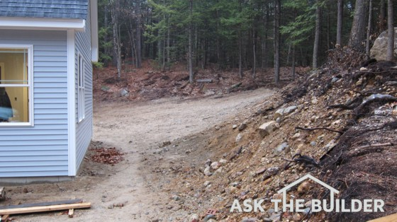 Storm water is going to rush down the hill on the right and overwhelm this home!. Photo Credit: Tim Carter