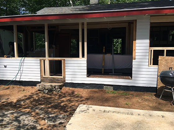 This summer cabin in the woods of Maine is going to become a year-round home after the extensive remodel. Photo Credit: Rick Bader