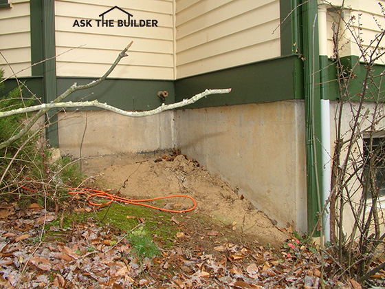 Tips on foundation soil grade around houses ask the builder you can see that more than 6 inches of foundation wall is exposed above the orange extension cord on the right side of the photo the foundation height is solutioingenieria Gallery