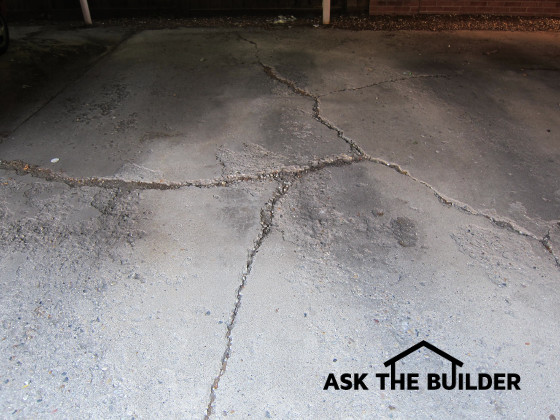 Cracked Concrete Carport & Rubbing Door