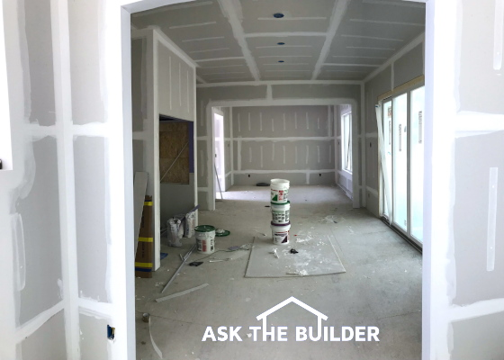 drywall being finished new home