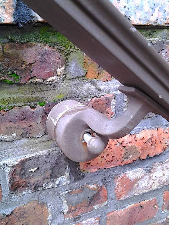 repair handrail in brick or concrete