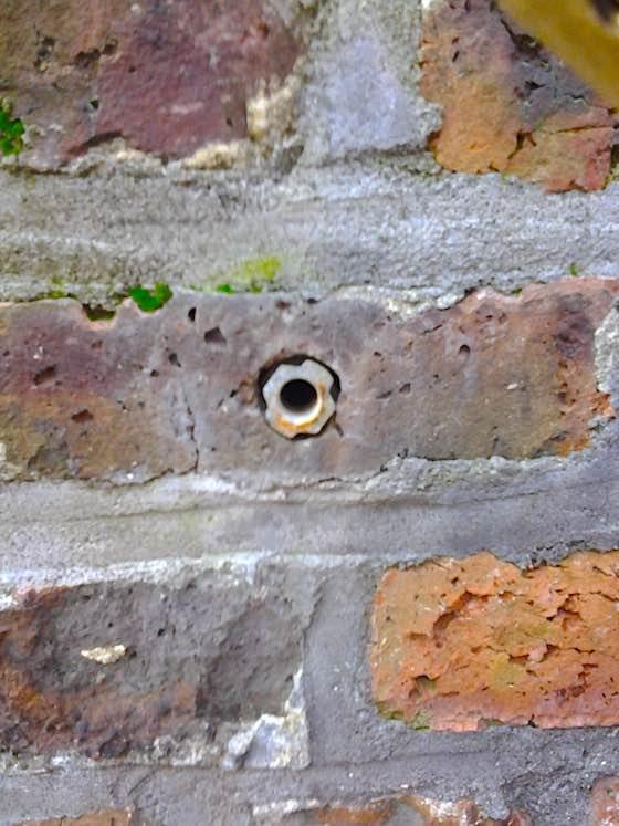 repair handrail in brick