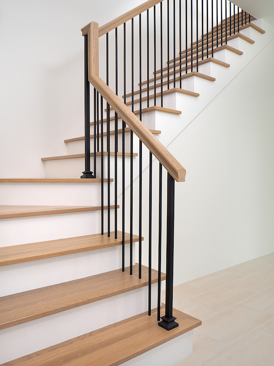wood staircase with iron balusters new house